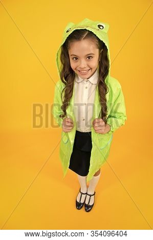 Frog Style. Schoolgirl Hooded Raincoat Enjoy Fall Weather. Rainproof Accessories Make Rainy Fall Day