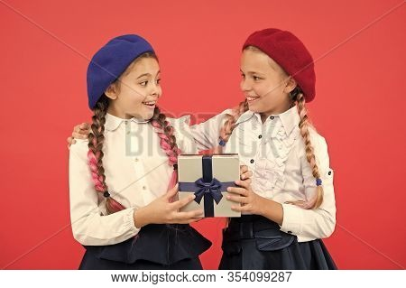 Surprise For Both. Girl Giving Gift Box To Friend. Girls Friends Celebrate Holiday. Children With Wr