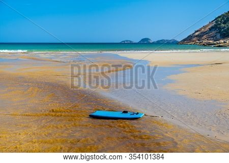 Boogie Board Drifting On Tidal River Waters Into The Ocean At Norman Beach. Wilsons Prom, Australia