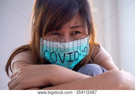 Asian Woman Worry And Fears Wearing Mask, Writes Covid-19 The Situation Of The 2019-ncov Virus Infec