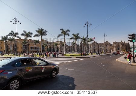 Lima / Peru - May 10 2016:  Municipal Buildings In The Plaza Mayor De Armas With Walking People And