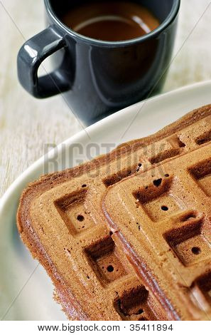Homemade Brown Waffles On The Plate With A Cup Of Coffee