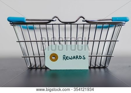 Customer Rewards And Fidelization Incentives, Shopping Basket With Price Tag With Rewards Written On