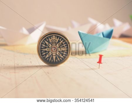 Close Up Of A Compass And Location Marking With A Red Pin On Sea Map. Adventure, Discovery, Navigati