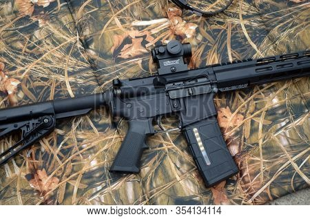 Modern AR15 rifle with a sight aim. Unformal shooting range near Kiev. Former Soviet military base.March 4, 2020. Kiev Region, Ukraine