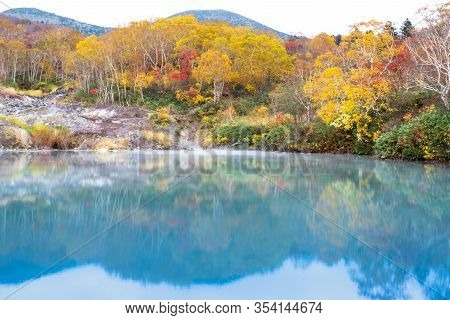 Jigokanuma Pond View On Isolated Sky, The Water From Hot Spring, Soft Blue Forest Onsen Lake With Wa