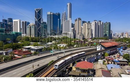Kuala Lumpur Skyline With View Of Lrt And Blue Sky Background