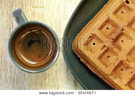 Homemade Brown Waffles On The Plate With A Cup Of Espresso