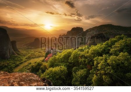 Monastery Meteora Greece. Stunning Spring Panoramic Landscape At Sunset. View At Mountains And Green