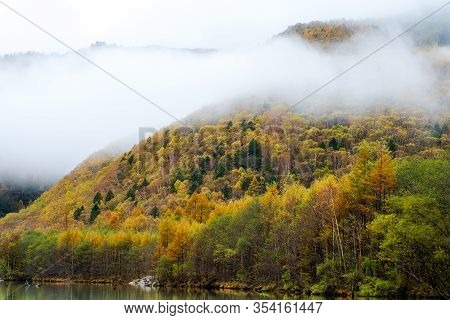 Close Up Mountain Range In Autumn With Clouds At Lake Taisho, In Kamikochi National Park Focus On Co