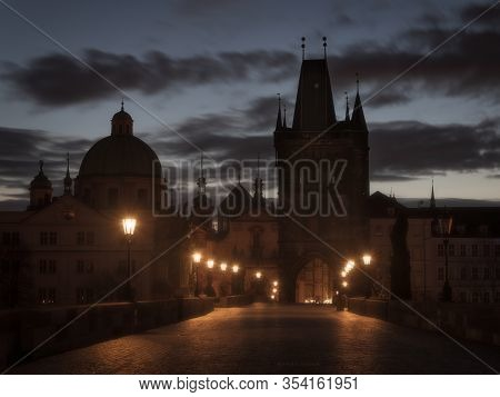 Calm, Moody Morning At Charles Bridge In Praha. Just Before Sunrise This Famous Place Is Magical, No