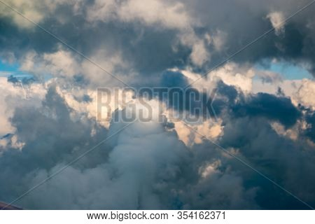 Fluffy White Clouds Against The Blue Sky