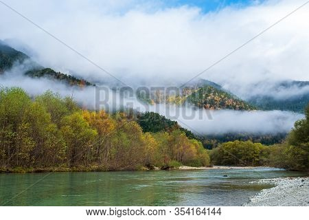 Lake Taisho View Point In Autumn Season, Water Reflection And Blue Clouds Sky ,a Lot Of White Fog At