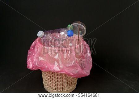 Plastic Bottle In A Trash