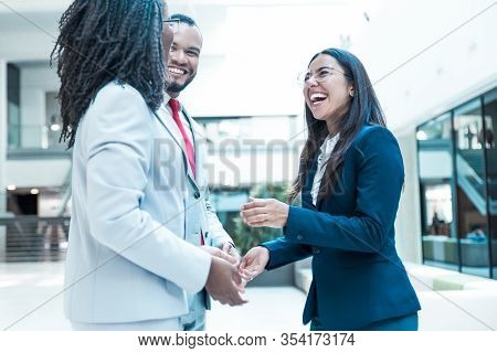 Joyful Diverse Business Colleagues Chatting During Work Break. Business Man And Women Standing In Of