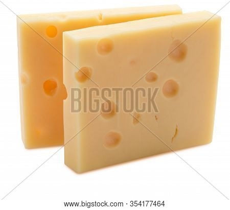 Two Portions (blocks) Of Emmental Swiss Cheese. Texture Of Holes And Alveoli. Isolated On White Back