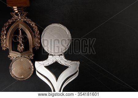 Golden trophy over blackboard background. top view. flat lay.Trophy is a specific achievement, serves as recognition / evidence of merit, awarded for sporting events