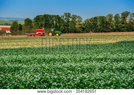 Baikivtsi, Ternopil Region, Ukraine - July 06, 2019:tractor Cultivated With The Simultaneous Introdu