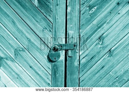 Wooden Door With Lock In Cyan Tone. Abstract Architectural Background And Texture For Design.