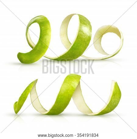Peeling Green Apple On A White Background