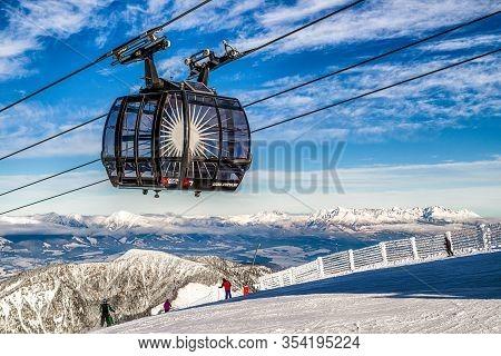 Demanovska Dolina, Slovakia - December 2: Ropeway Funitel And Skiers On Hill Chopok In Resort Jasna
