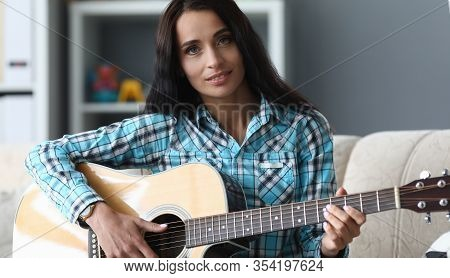 Beautiful Girl With Acoustic Guitar In Her Hands. Learning To Play Instrument, Basic Chords. Girl De
