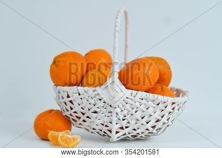 Tangerines In A White Woven Basket Against A White Background.winter Vitamin C. Avitaminosis.new Yea