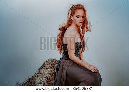 Beautiful Furious Scandinavian Warrior Ginger Woman In Grey Dress