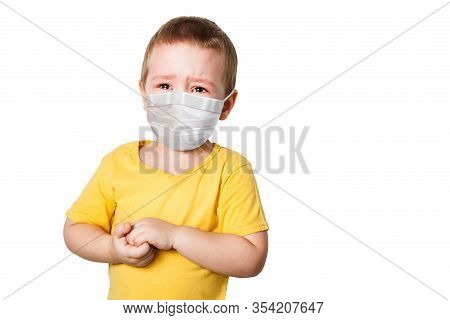 Worried Child Wearing A Protective Face Mask To Prevent Corona Virus Infection Or Pollution On White