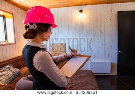Construction Inspector Woman Writes Notes Using A Clipboard, Bedroom Inspecting During Home Indoor A