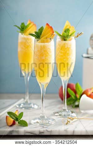 Summer Time Peach Mimosa Or Bellini In Flute Glasses, Brunch Cocktail