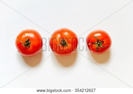 Trio Of Fresh Red Tomatos Isolated In White Background Viewed From Above - Flatlay Look