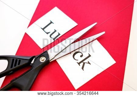 Close-up Of The Red Book On It Are Scissors And A Piece Of Paper With The Inscription Luck, The Shee