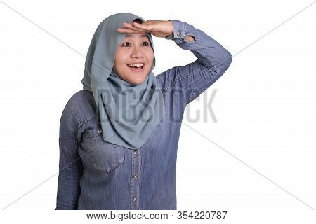 Young Asian Muslim Woman  Looking Far Ahead, Frowning And Search For Something In Distance Or Future