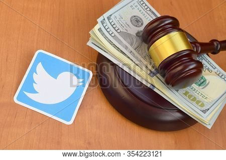 Twitter Paper Logo Lies With Judge Gavel And Hundred Dollar Bills. Entertainment Lawsuit Concept