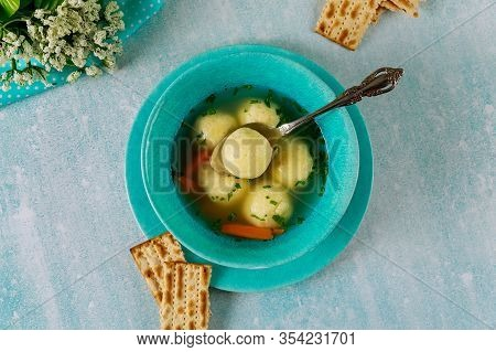 Chicken Broth With Matzo Balls And Matzos Bread. Jewish Holiday Pesach.