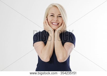 Beautiful Middle-aged Woman With Excellent Skin Holds Her Face With Palms Closeup.