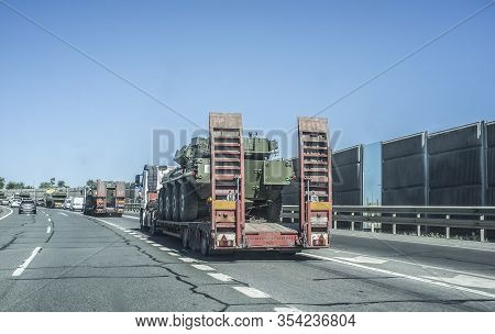 Seville; Spain - May 31st, 2019: Heavy-duty Truck Carrying A Spanish Army Wheeled Tank. Road Convoy