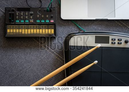 Top View Of Drum Pads With Drumsticks, Fm Synthesizer And A Laptop. Music Concept.