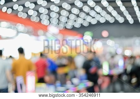 Blurred Exhibit Showcase Background Unspecific People Shop In Grand Sale Fair And Showcase Advertise