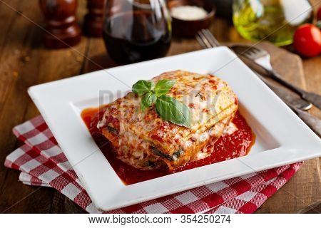 Classic Lasagne Piece On A Plate With Basil Leaf On Top