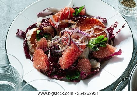 Sicilian Salad With Fennel, Oranges, Grapefruit And Radicchio Salad With Balsamic Dressing On A Blue