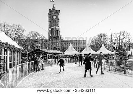 People On Ice Skating Rink On Christmas Market At Alexanderplatz.