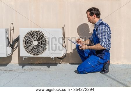 Man Doing Heating, Ventilation, And Air Conditioning Inspection