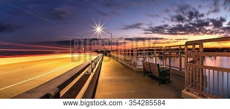 Light Trails From Cars Headed Across The Ss Jolley Bridge Into Marco Island, Florida.