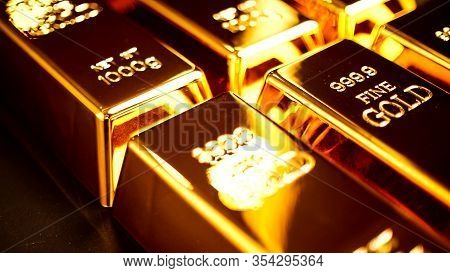 Many Gold Bullions Brighting On The Table.