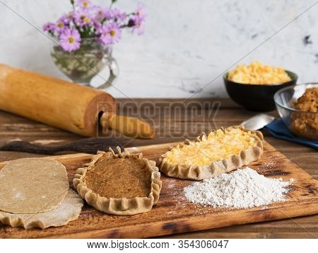 Cooking A National Dish - Karelian Pies. A Traditional Dish Of Karelia And Finland From Rye Flour Wi