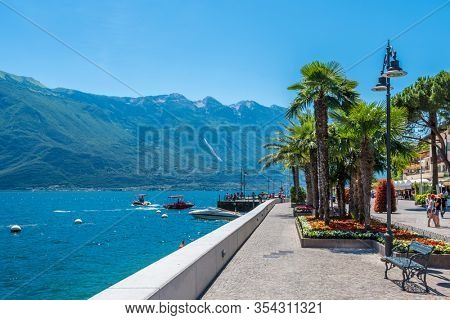 LIMONE, ITALY, JUNE 19, 2017: TOURISTS ON THE STREETS IN THE CENTRE OF LIMONE.