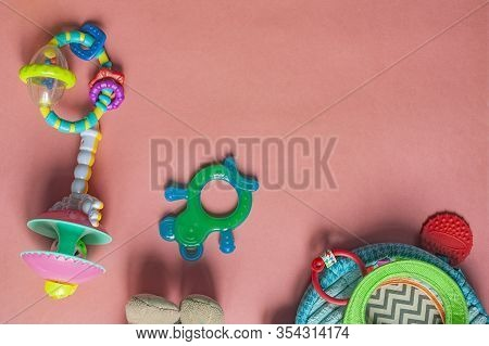 Baby Toy For Teething. Baby Chewing Toy. Teething And Itching Gums For Baby On Pink Background