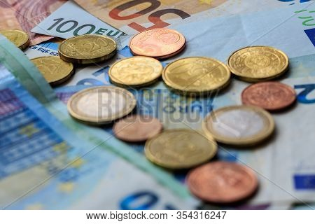 World Of Money. Various Euro Notes And Coins As Background. Selective Focus.
